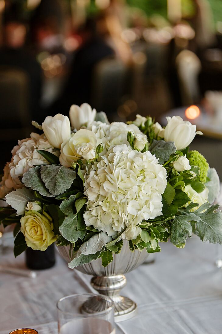 """Talia wanted to keep things elegant with a neutral white and green combination for her floral arrangements. """"Mt. Lebanon Floral did all the flowers for our big day and I could not have been happier with the results."""""""