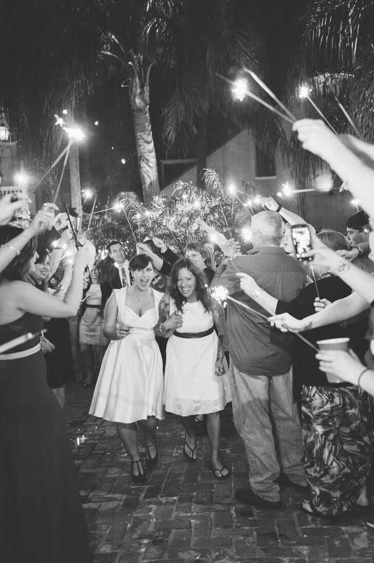 Friends and family sent the newlyweds off in a blaze of bright sparklers.