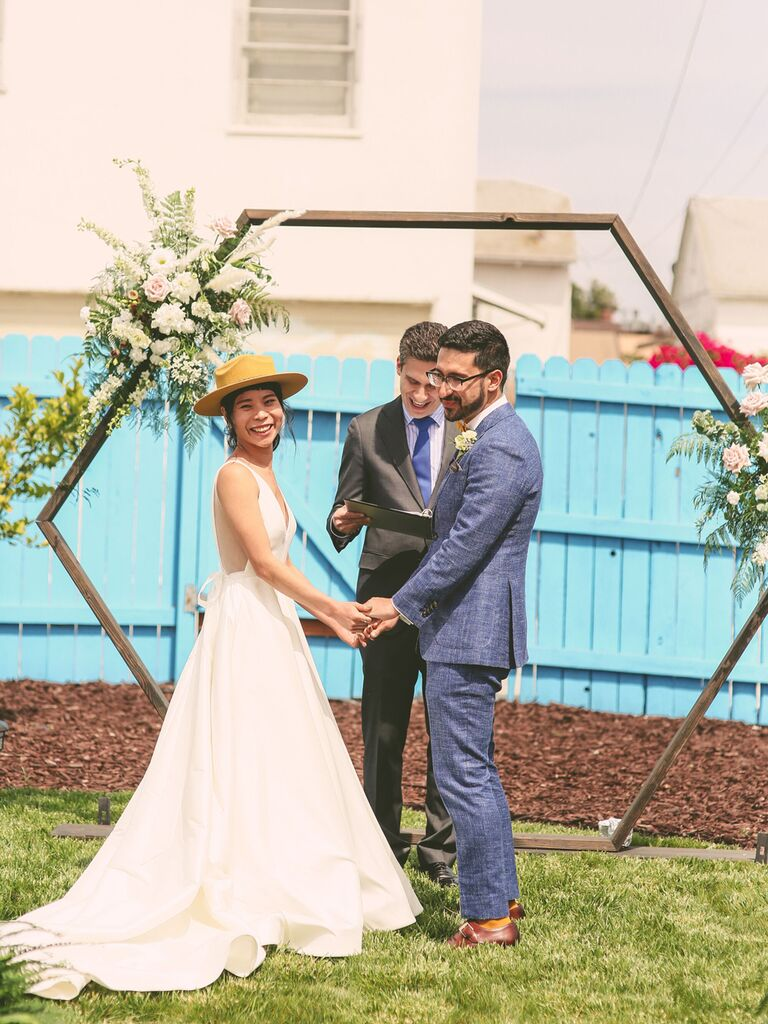 Modern couple reciting vows at wedding ceremony