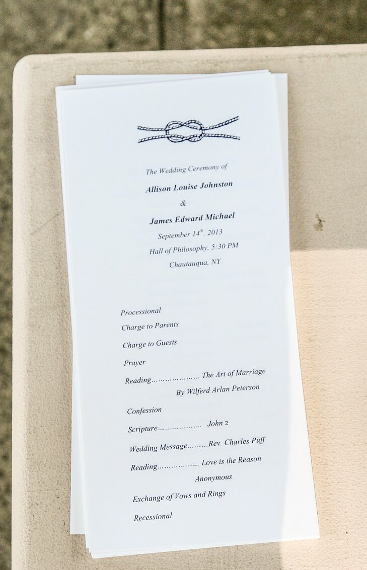 The couple created their ceremony programs on their own with classic nautical rope print detailing.