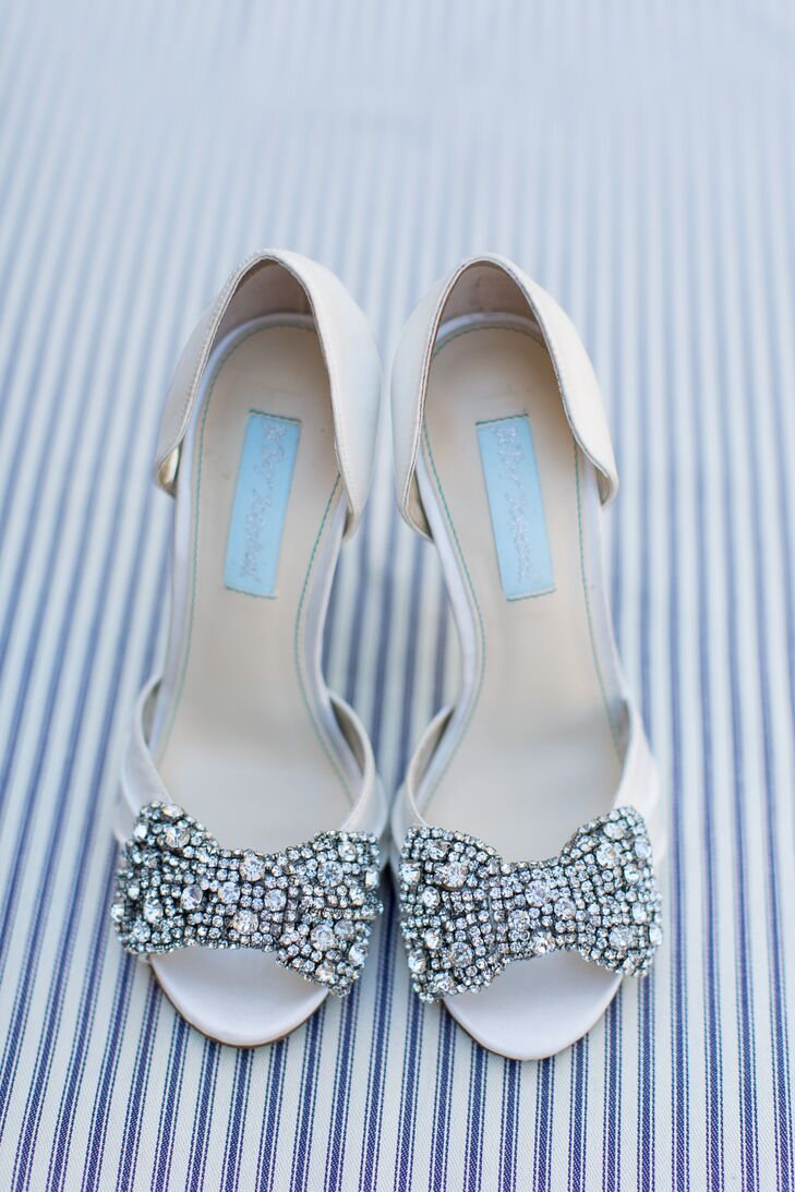 Brooke picked out a pair of white Betsey Johnson heels, with crystal-accented bows topping the toes for a glamorous touch. She also loved the shoes'  blue bottoms.