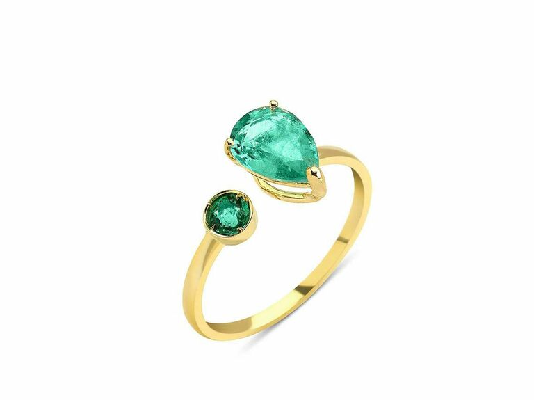 emerald two stone ring with round cut emerald and pear shaped emerald
