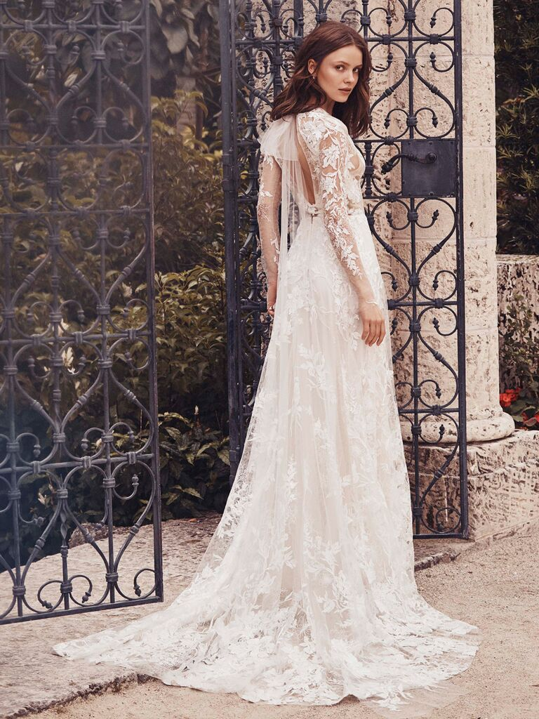 Monique Lhuillier Spring 2020 Bridal Collection lace wedding dress with long sleeves and back bow
