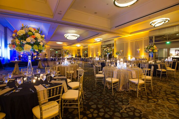The traditional ballroom reception took place in Buckhead, Georgia at The Grand Hyatt Hotel with a cobalt blue, ivory and green color palette.