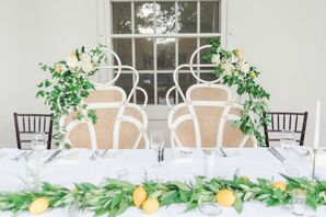Sweetheart Table with Elegant Chairs, Greenery Garland and Lemons