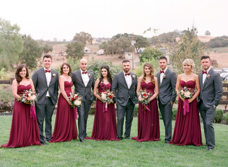 Refined but not stuffy, the attire of the bridal party reflected the mood of the outdoor vineyard setting. Groomsmen wore dark gray suits with deep crimson bow ties to match the merlot strapless bridesmaid gowns.