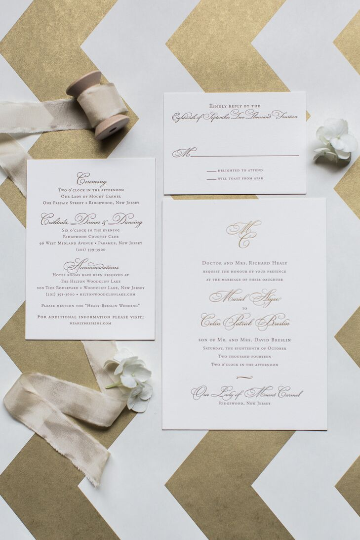Each piece of their invitation suite matched the couple's timeless style to a T. Designed by the Village Invites, it stood out with regal gold script against a solid-white card stock. We love how Angela Newton Roy Photography strategically placed it on a modern, matching chevron backdrop!