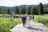 Inspired by the natural beauty of their wedding's serene outdoor setting, Sara Slade and Frank Royster planned a rustic summer fete with an eclectic m
