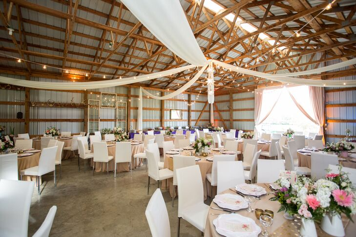 Even though Haley and Michael had their reception in a rustic, working barn, they weren't afraid to make it look super-modern. The neutral beige and white color scheme was really timeless, and draping and string lights added a little romance.