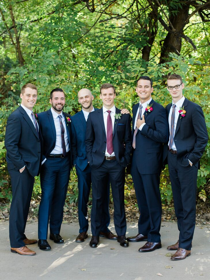 The five groomsmen wore their own navy suits with a geometric patterned tie.