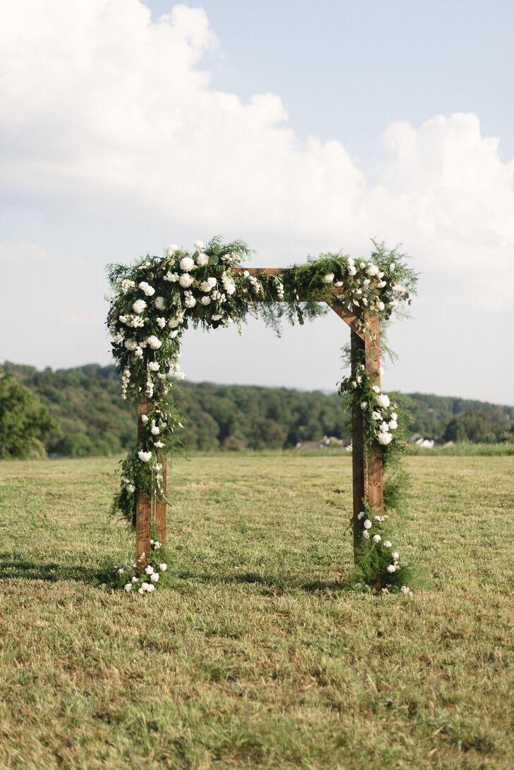 Wooden Ceremony Arch With Greenery