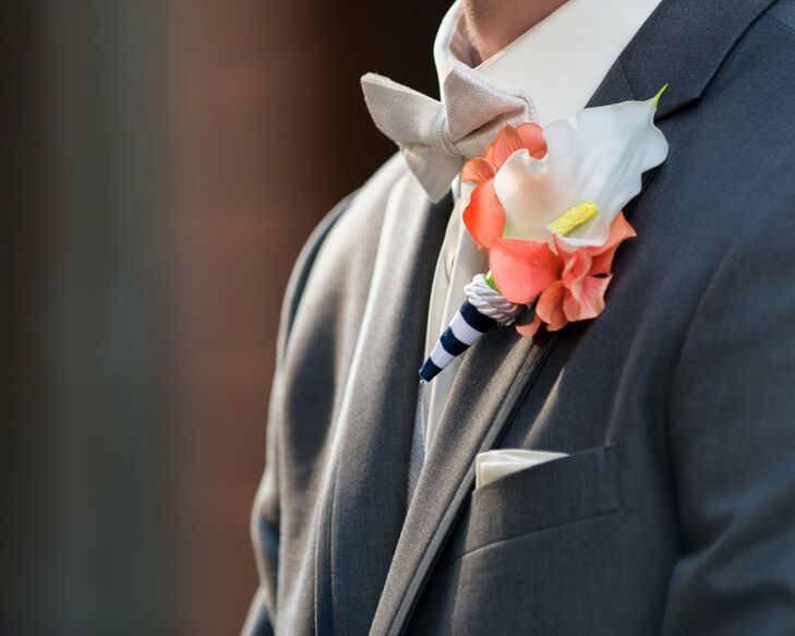 Sean stood apart from his groomsmen with a white bow tie and elegant white calla lily.  A navy striped ribbon adorned with rope and added a whimsical touch to the elegant DIY boutonniere crafted by the bride.