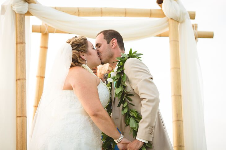 The ceremony took place on the beach near the waterfront in Oahu, Hawaii, where Veronica and Tim shared their first kiss in front of the bamboo wedding arch.