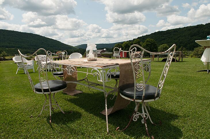 Mary and Sam's cocktail hour took place outside on the field at the Maple Shade Farm where guests sat at mismatched, vintage-style tables.