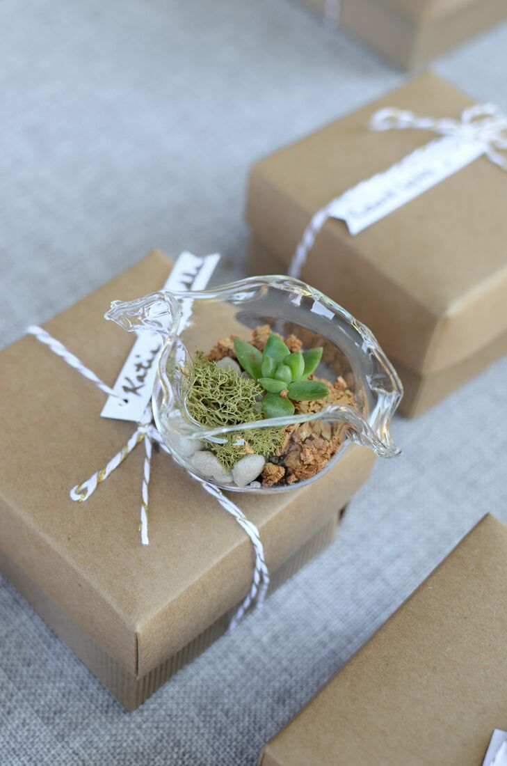 Nicole's love for succulents showed through the choice of wedding favors, which were handblown glass terrariums filled with moss and, of course, succulents. The favors were packed inside boxes and given to guests to remember the special day.