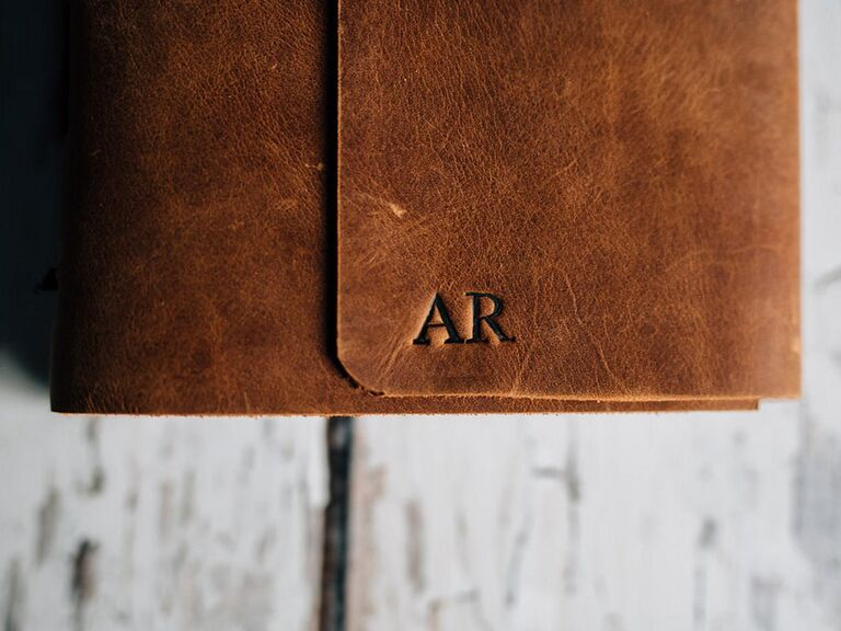 Brown leather notebook stamped with initials