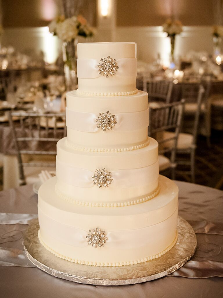 Winter Wedding Cake Idea With Metallic Snowflakes And Satin Ribbon