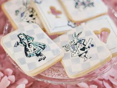 Decorated Alice In Wonderland–themed cookies for a whimsical wedding