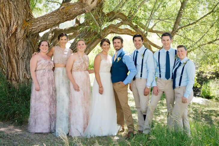 The bridal party wore subtly floral dresses in complementary styles, and the groomsmen donned khakis with suspenders.