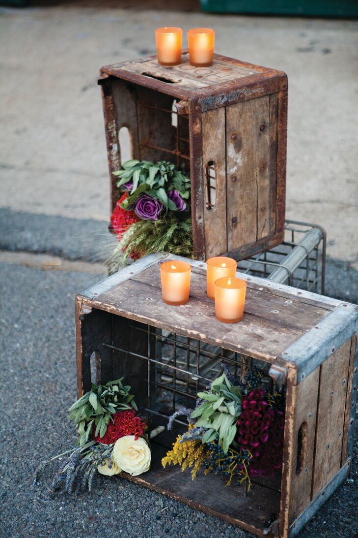 Repurposed wooden crates were topped with fresh florals and votive candles, adding to the day's rustic and antique vibe.