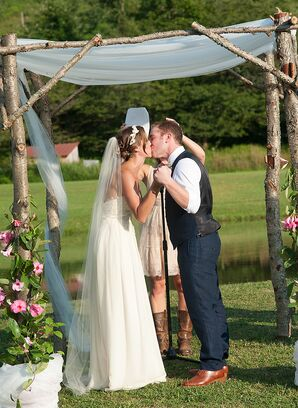First Kiss Under Wooden Ceremony Arch
