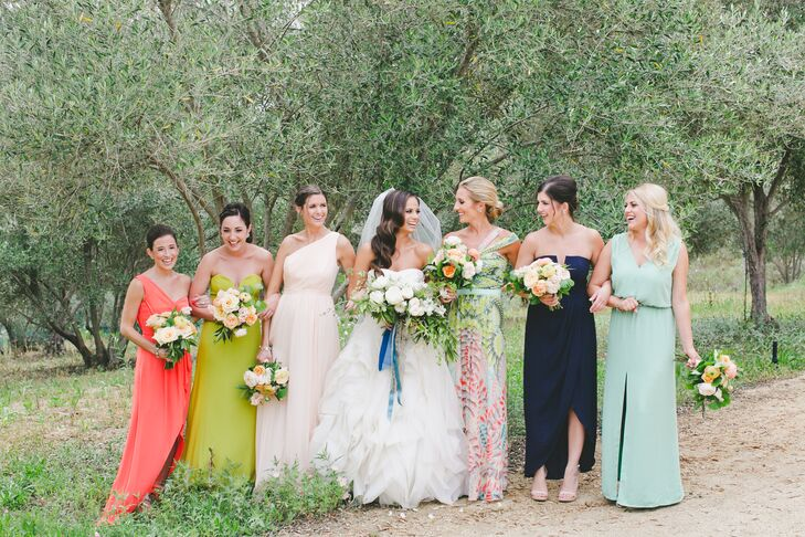"""My bridesmaids wore a mix of dresses that I handpicked for them,"" Carly says. ""I chose my maid of honor's dress—a print fabric—and then pulled colors from her dress for my other bridesmaids for a cohesive look."""
