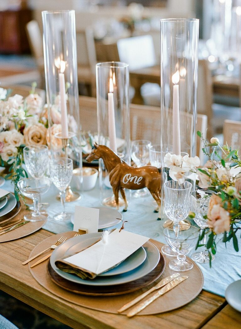 Rustic tables cape with calligraphed horse table number