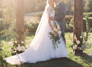 Brittany Nelson (21) and Bailey Acee (20) wed in the garden of Riverview Evangelical Free Church in Bonsall, California, with a classic, romantic aest