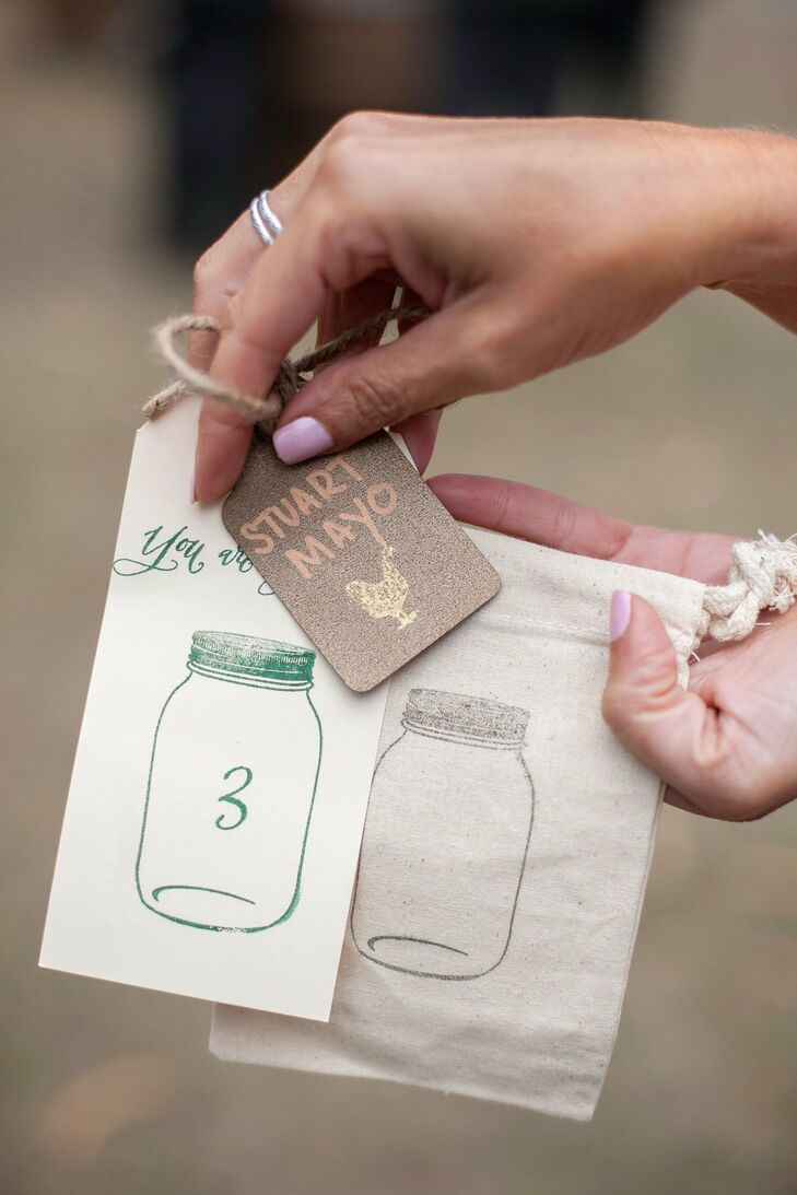 A cute mason jar stamp was used throughout the celebration, turning up on the escort cards and the favor bags.