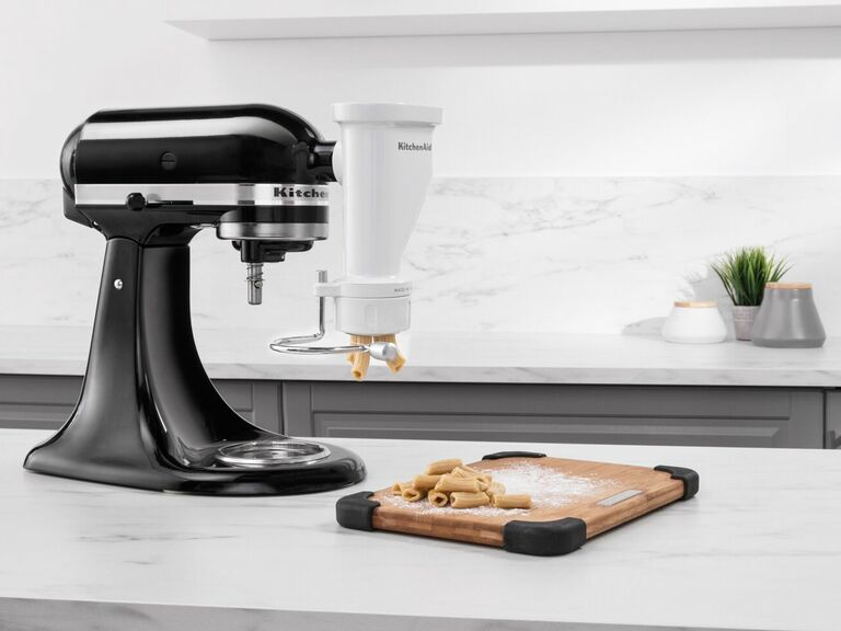 KitchenAid stand mixer on counter making pasta