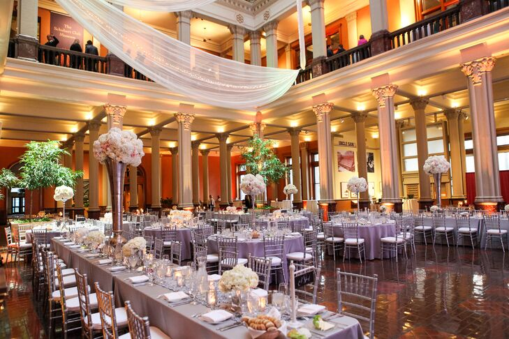 The Landmark Center's unique architecture, with stately columns and an impressive five-story atrium, infused the wedding with an air of elegance, charm and grandeur. The addition of tall centerpieces, airy fabric panels, candles and uplighting complemented the historic venue's impressive characteristics, while giving the space a romantic twist to bring Lindsay and John's vision to life.