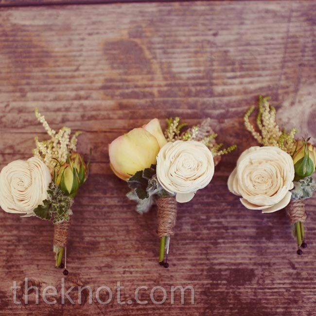 The guys wore white tea roses accented with greens and wrapped with twine.