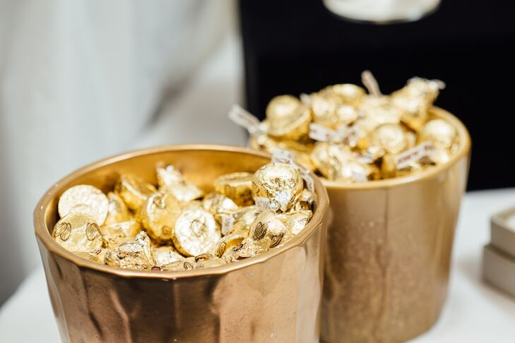 Gold-wrapped Hershey's Kisses in gold containers helped tie in the color gold during the reception.
