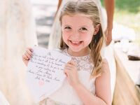 Smiling flower girl with custom handkerchief wedding gift