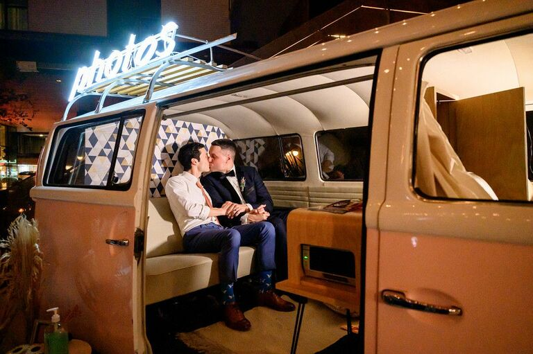 Couple kissing in vintage van photo booth