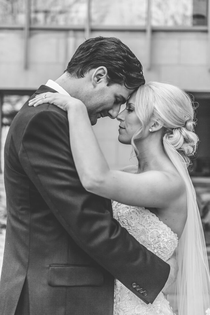 As Corinne and John shared an intimate moment,  Corinne's fingertip-length veil accented with scallop lace draped down her back. She pinned the elegant veil under her messy bun updo.