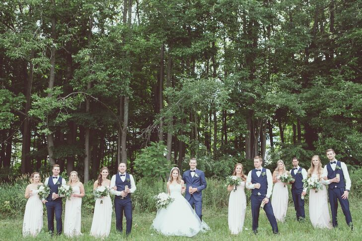 """Northbrook Farms provided a picturesque backdrop for the couple and their bridal party to have their photographs taken. """"The venue itself was beautiful, with lovely perennial gardens, tall trees and lush greenery outlining get property,"""" Kelly-Ann says. """"Not to mention the 1800s home on the property, which my girls and I got ready in."""""""