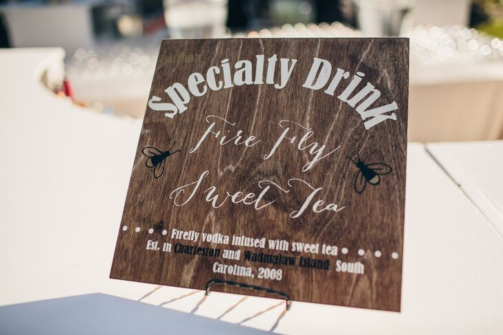 All the signage at the wedding—the cocktail-franks sign, the photo montage, the photo-booth sign—were handmade by Heather and David. Their signature cocktail was firefly sweet tea, with vodka and sweet tea, a local favorite.