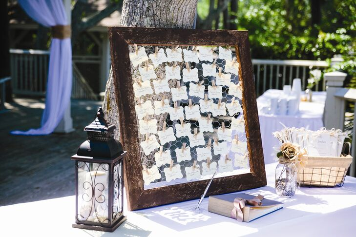 The handmade escort cards were clipped with clothespins to a chicken wire frame.