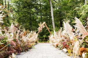 Bohemian Ceremony Site with Triangular Wedding Arch and Dried Grasses