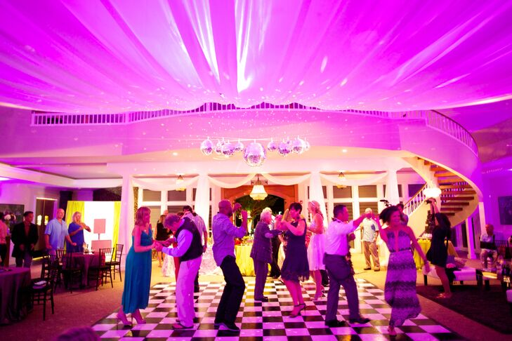 Guests enjoyed dancing on the elegant black and white checkered dance floor at the reception.