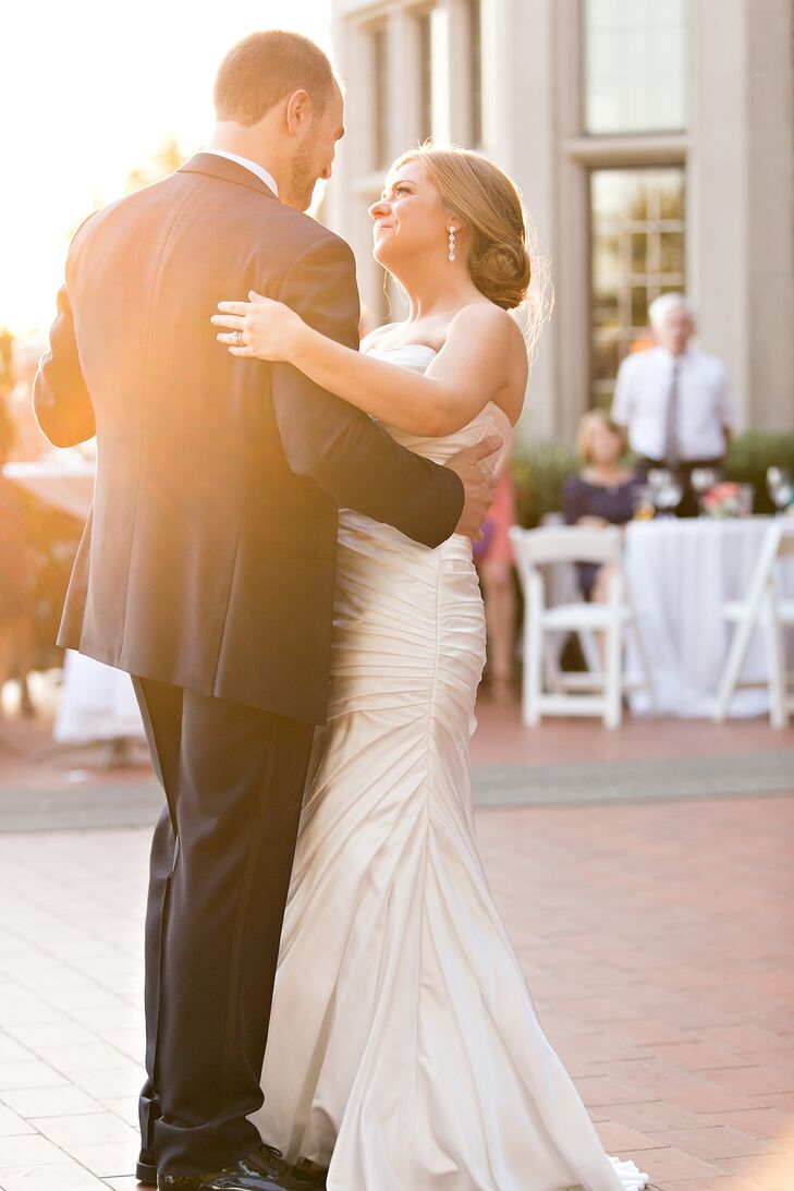 """The couple put their own personal twist on the traditional wedding schedule, taking to the floor for their first dance during cocktail hour, allowing the rest of the evening's festivities to flow smoothly. The pair danced to Billy Joel's """"Just the Way You Are,"""" then led guests into the Wavney House grand hall for dinner and more dancing."""