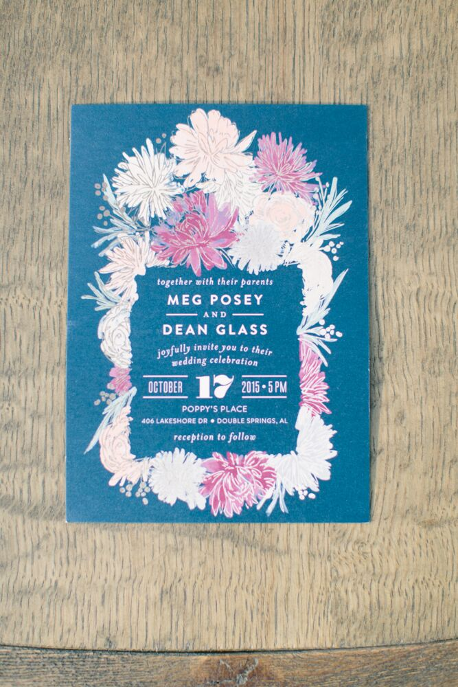 The couple's invitations were printed on deep blue stock in white ink and featured an abstract pink and white floral border.