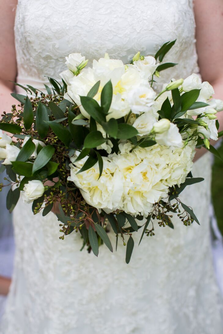 Kathryn carried a lush bouquet of white roses and peonies, offset by seeded eucalyptus leaves.