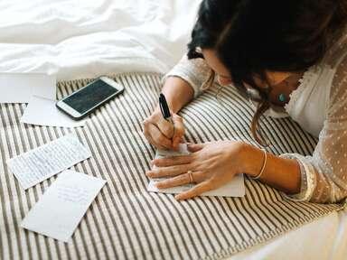 bride writing wedding vows