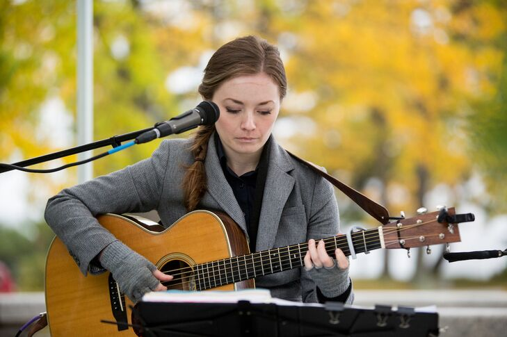 """Boston-based folk guitarist Lindsay Straw provided the ceremony music. The bride walked down the aisle to Van Morrison's """"Brown Eyed Girl."""""""