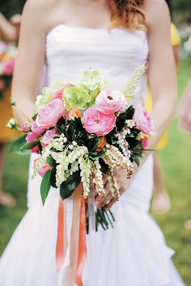 Katie's loosely gathered bouquet was a colorful medley of pink garden roses, peonies, orchids and leafy greenery.