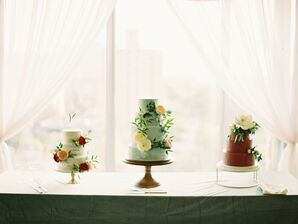 Assorted Tiered Wedding Cakes with Mismatched Stands and Fresh Flowers