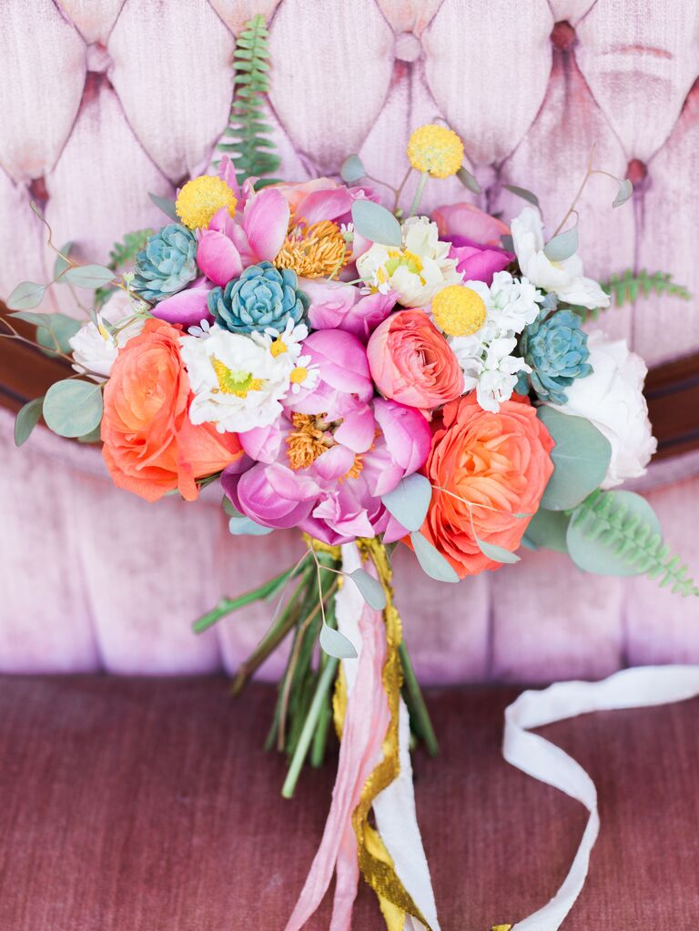 Bright wedding bouquet with peonies and ranunculus