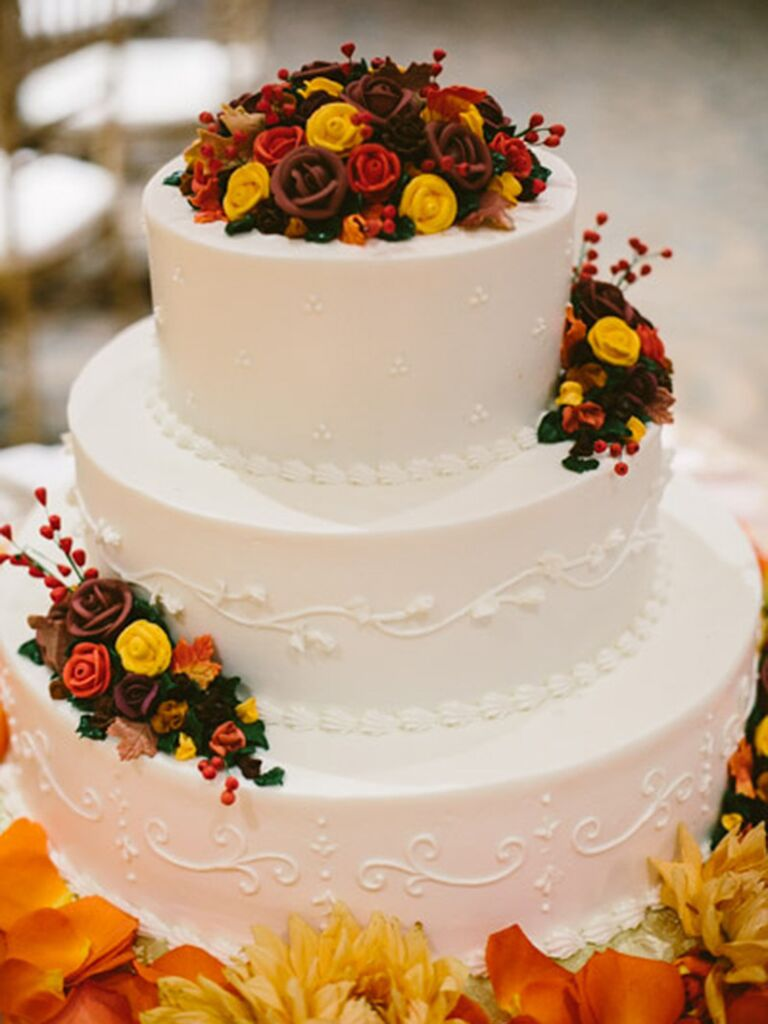 Fall Wedding Cake With Red Orange And Yellow Ercream Roses